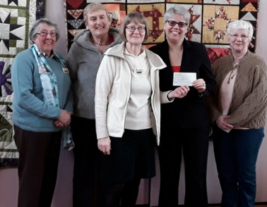 Donation from Kettering Quilters is a welcome boost for dementia patients